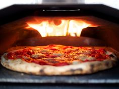 Enjoy the best tasting pizza any time with the Uuni Portable Wood-Fired Pizza Oven. Weighing just 23 pounds total, this pizza oven comes with its own Wood Fired Oven, Wood Fired Pizza, Portable Pizza Oven, Fire Pizza, Wood Pellets, Pizza Bake, Kitchen Stove, Kitchen Appliances, Rocket Stoves