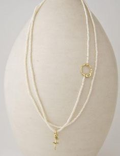 """looks like- 40-44"""" strand, anchored on a ring, add a pendant. Pretty!"""