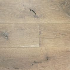 BARTEK from the RUSTIC MODERN collection by reSAWN TIMBER co. features the unique character and grain pattern of our original cut White Oak.