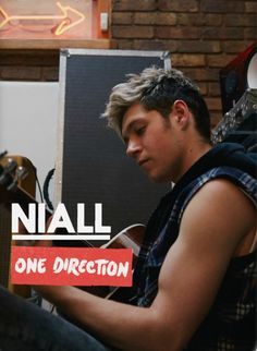 Niall, such a doll, and look at those muscular biceps !!