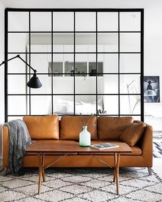 When living in a small space, as almost everyone does in NYC - I'm always on the lookout for clever ways to enhance apartment living. I first saw this concept in @roomandboard Chelsea's showroom. Screen & divide your space with a mock industrial glass screen, minus the glass. This home was photographed by @fantasticfrank & shows us how this design feature shields & separates the sleeping area from the lounge room - pure genius!! | Steph #designer #inspiration #inspire #industrial #leather…