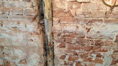 Brick wall. Industrial lamp. Cool industrial light. Old wall with Metal pipe.