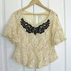 NWOT Free People Ivory Lace Layering Overshirt Brand new. Never worn. This is a Free People Ivory Lace with black embellishments layering shirt. It's a size small/petite. No flaws! Free People Tops Blouses