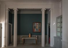 Farrow & Ball. A living room painted in Peignor No.286 Estate Emulsion, with the feature wall painted in Inchyra Blue No.289 Estate Emulsion. The woodwork and floorboards are painted in Worsted No.284 Estate Eggshell and Floor Paint respectively.