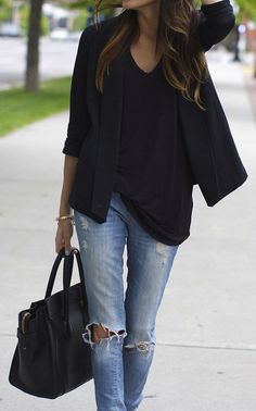 Black loose shirt, black structured blazer and ripped denim