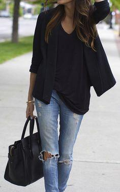Black loose shirt, black structured blazer and ripped denim