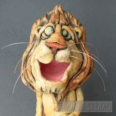 Ceramic Lion Sculpture Wall Hanging by RudkinStudio on Etsy https://www.etsy.com/listing/241411348/ceramic-lion-sculpture-wall-hanging