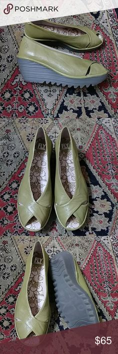 Fly London Yaff Wedge Green leather Fly London wedges. Sturdy and cute in an eye-catching color. In really great pre-loved condition inside and out these are really clean. Tip of the toe to back of heel measures 9 1/2 inches. Fly London Shoes Wedges