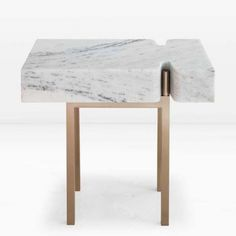 "W 24"" x D 16"" x H 20""  The top of the Terranova Side Table is hewn from a single block of Statuary marble and then set atop a solid silicon bronze base.  This piece is also available in custom sizes and other metal finishes."