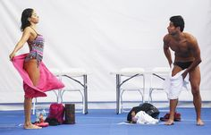 Olympic refugee team swimmers Yusra Mardini (L) and Rami Anis dry off after training at the Olympic Aquatics Stadium ahead of the Rio 2016 Olympic Games on July 28, 2016 in Rio de Janeiro, Brazil. Both swimmers are refugees of war-torn Syria and survived making the dangerous journey from Syria across the Aegean Sea to Greece in boats. The International Olympic Committee will for the first time have a team made up of stateless refugees. (July 27, 2016 - Source: Mario Tama/Getty Images