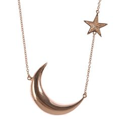 Take in the city lights and shine like the moon in this crescent necklace.