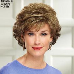 Easy-to-wear mid-length wig with flattering waves and volume.