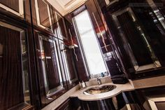Superyacht-spec powder room / WC. With eglomisé mirrors and lacquered wood storage : Grade II Listed Georgian Cheshire home restored and modernised