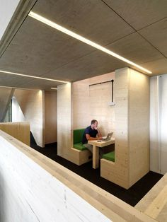 A 64-metre-long wooden structure frames meeting areas in this London office