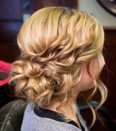 Romantic mussed hairstyle by Stephanie Brinkerhoff. Love! #hotonbeauty hotonbeauty.com #mussedchignon #messyupdo