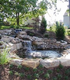 Water feature: Backyard waterfall. #landscaping www.HomeChannelTV.com