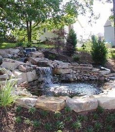 Water feature: Backyard waterfall. #landscaping www.HomeChannelTV.com