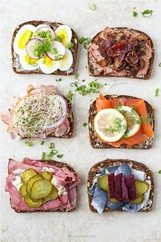 Danish smorrebrod open faced sandwiches with liver pate, smoked salmon, herring, roast beef, egg and pork bacon. A delicious smorrebrod appetizer or lunch. Rolled Roast Beef, Sliced Roast Beef, Sandwiches, Open Faced Sandwich, Pork Bacon, Scandinavian Food, Good Food, Yummy Food, Meat Appetizers