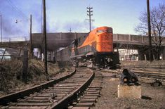 LIRR #200 as delivered (note: fuel tanks) at Mineola eastbound passing under Mineola Blvd.1963