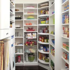 Love this pantry--especially the lazy suzy and the rods for tablecoths!