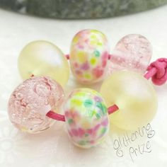 Colour your world 🌈 Cute lampwork spacer beads in a soft colour theme, incorporating pastel pink; yellow and greens. The yellow beads have a soft violet shimmer.They measure 12x8mm approx. Love handmade, buy handmade. These are made to order, each pair will be unique. Please allow time for delivery, generally 1-2 weeks.  Pastel Pink, Pink Yellow, Lampwork Beads, Soft Colors, Color Themes, Glass Beads, My Etsy Shop, Jewelry Design, Jewelry Making