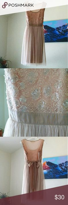 """a'reve champagne cocktail dress L Blush peach champagne sleeveless dress with sequined lace bodice and pleated tulle skirt. Features side zipper and tie back waist. Very light spot on the back, reflected in price, otherwise excellent condition. Lying flat bust measures 18"""", waist 16"""", length 37 1/2"""". a'reve  Dresses"""