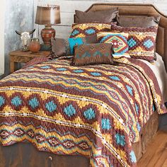 A Lone Star Western Décor Exclusive - Bold, sunset-inspired colors highlight this oversized, lightweight polyester bedding featuring banded diamond patterns with a coordinating reverse. Sets include quilt and two shams (king has king shams). Machine wash.