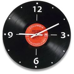 Give your anniversary couple the gift of groove with this funky and easy-to-read LP Record Clock, made with vintage LPs and their original artist labels. More 40th #anniversary gift ideas on: http://blog.gifts.com/gift-guides/40th-anniversary-gift-ideas