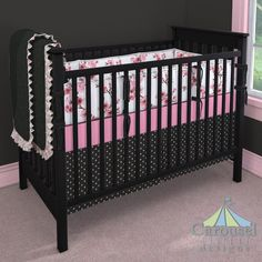 Crib bedding in Black and Pink Dot, Solid Black Minky, White and Pink Rosettes, Pink Cherry Blossom, Solid Black, Bubblegum Pink Satin. Created using the Nursery Designer® by Carousel Designs where you mix and match from hundreds of fabrics to create your own unique baby bedding. #carouseldesigns
