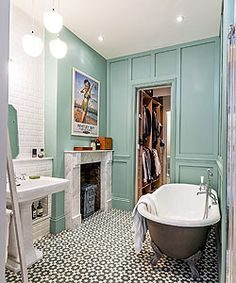 Basically, this is my dream bathroom! In love with the paint color, plus the paneling to add texture and personality without clutter. Color: Farrow & Ball's Arsenic Green.