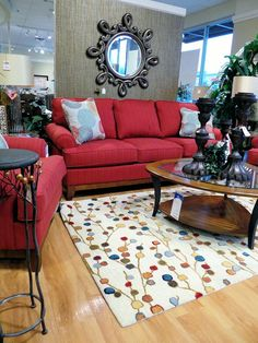 #momcave - I love the serious looking sofa and the whimsical carpet.