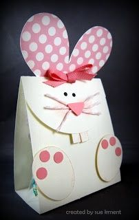 Make from cardstock and scrapbook paper, tuck a bag of Easter treats inside it.