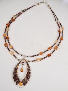 Harmony Scott Jewelry Design - Goddess Necklace with Garnet, Citrine, and handmade hoop by Harmony
