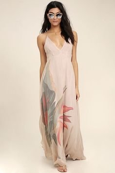 Lulus Exclusive! Take a tropical trip in the Island Delight Blush Pink Floral Print Maxi Dress! A large, exotic flower, in shades of red, orange, and green, embellishes the full skirt of this gauzy woven maxi dress. Adjustable straps (with tasseled ends) support a darted, triangle bodice, then crisscross and tie atop an open back, with elastic for fit.
