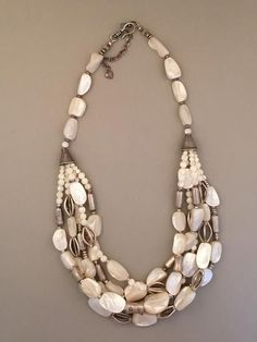 "Beads: Mother of Pearl, Sterling Silver Dimensions: 25"" + 3"" extender This is a heavier piece."