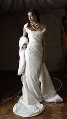 The Ava gown by couture bridal designer Angelina Colarusso.  Flattering draped silk over an integral corset makes this the perfect wedding dress for the mature bride. Fur shrug- wedding accessories by Angelina Colarusso. -wedding dresses for older bride - second time wedding dress - mature bride wedding dress
