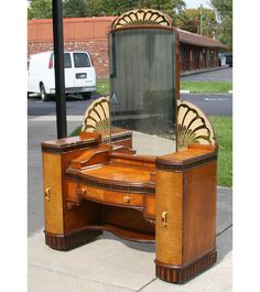 Art Deco American vanity, with architectural design inspired by William Van Allen, architect of the Chrysler Building.
