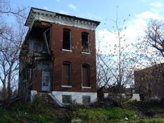 House, East St. Louis; burned buildings & cars; abandoned homes...pretty sad place.