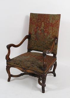 """Carved Regence style fauteuil with needlepoint seat and back, Argentine. CIRCA: Early 20th Century DIMENSIONS: 45"""" h x 29.5"""" w x 28.75"""" d"""