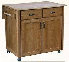 Amish Rolling Utility Kitchen Island With A Maple Drop-Leaf Top In A Hickory Wood Base Helpful, attractive and custom made for your kitchen. Enjoy casual dinners, a place for food prep, added storage and more. Built in choice of wood and stain. #kitchenislands