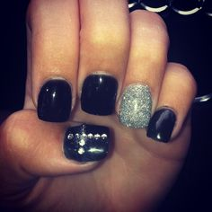 black and silver nails with rhinestone cross! Too Cute!
