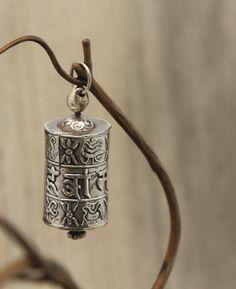 Tibetan prayer wheel pendant, made in Nepal. Available at BuddhaGroove.com.