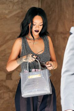 Riri - bold dark lip and charcoal grey outfit - on point