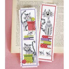 "Pussycat Bookmark Set PURR-FECT BOOKMARKS for cat lovers. Counted cross stitch kit includes 14-count white Aida cloth, presorted DMC cotton floss, needle, chart and directions. Set of two, each 2 1/2"" x 8"". Imported from Belgium. A Stitchery exclusive! **** Pussycat Bookmark Set Item #: T22681 Price: $18.99"