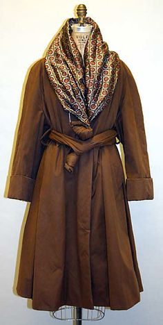 Romeo Gigli coat, worn with a printed scarf, tucked in just so....