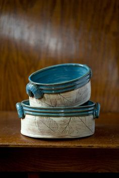 juliaedean on Etsy.com - Stoneware crock. Leaves from deciduous trees as well as plants are rolled by hand into this wheel-thrown form. The leaf impressions are stained with an oxide wash while the inside of the piece is glazed with a shiny blue glaze. Size - 8.5 x 4.5 inch.