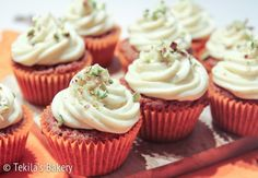 Carrot muffins with brown butter cream frosting and pistachios