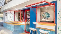 an 'urban surf' concept drove the design for the new poke poke restaurant in shanghai by studio doho. the 32 sqm project includes interior renovation and ground floor façade improvement of an ex. Coffee Shop Design, Cafe Design, Interior Design Studio, Store Design, Menu Design, Cafe Interior, Interior And Exterior, Surf Cafe, Design Bar Restaurant
