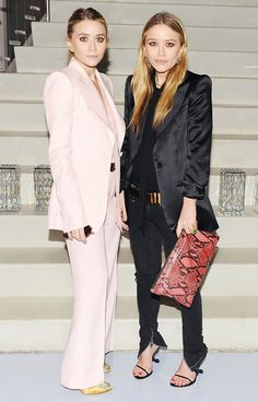 The Olsen twins make pantsuits elegant for evening in black silk and baby pink