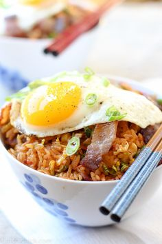 This Brussels Sprout Bacon Kimchi fried rice is a perfect one pot meal that can be made quickly and is everything hearty, warm, and satisfying. Sooo YUM|www.kimchichick.com